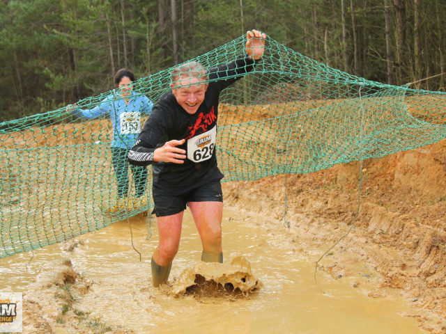 The Grim Challenge by 2.09 events. Whilst the cargo nets feature in many of the pictures, the race is more of a trail race with puddles than obstacle