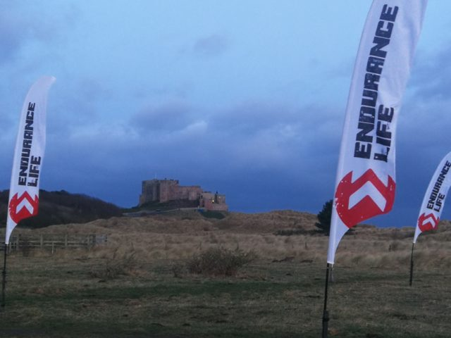 Snow clouds over Bamburgh on the morning for Endurance Life Northumberlands