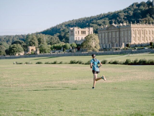 Peak X - a runner passes Chatsworth  - photo by Jake Baggaley